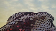 Fast People and reflections in front of a Futuristic Buildings - stock footage