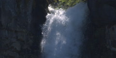 The lip of a waterfall dropping between narrow cliff walls - stock footage