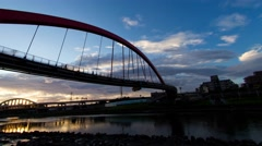 4K timelapse of Rainbow Bridge, from sunset to twilight with panning - stock footage