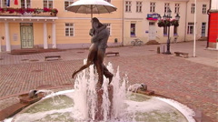 Aerial and slowmotion shot of the fountain in town square Stock Footage