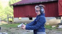 Man Instructing Daughter to Fire a Handgun Stock Footage