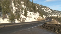 Transportation, transport truck winter highway thru frame Stock Footage