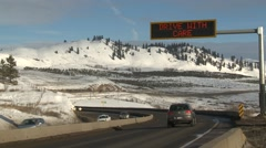 Stock Video Footage of Highway traffic warning sign, weather conditions, medium shot