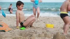 Children build sand castles - stock footage