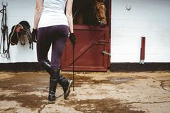 Rear view of jockey in stable Stock Photos