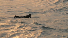 Slow motion movement of the surfer on the sea Stock Footage