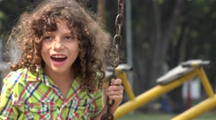Boy Swinging on Swing Set Stock Footage