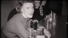 House father at fraternity house pours beer - 3174 vintage film home movie Stock Footage