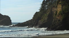 Waves washing into a rocky cove at Heceta Beach on the Oregon Coast Stock Footage