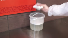 Wetting of the cleaning cloth in the wash liquor. Stock Footage