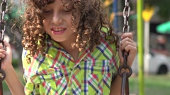 Mentally Disabled Boy on Swing Set Stock Footage