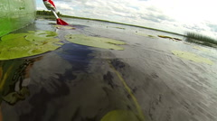 A red paddle paddling in the water Stock Footage