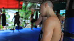 MMA Fighter Wrapping Hands In Muay Thai Class Training Hand Held Stock Footage