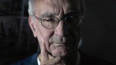 portrait of a white adult man, alone, dark, light - stock footage
