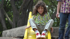 Mentally Disabled Boy on Slide Stock Footage