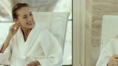 Beautiful girls in a bathrobes in the spa Stock Footage
