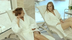 Women talking while relaxing in a spa - stock footage