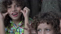 Brothers Acting Silly Outdoors Stock Footage