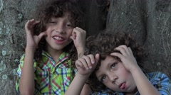 Brothers Acting Silly Outdoors - stock footage