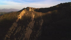 A close flight over rocky peaks in the San Gabriel Mountains of California. Shot Stock Footage