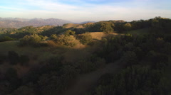 Close flight over brushy rounded hills in the San Gabriel Mountains, California. - stock footage