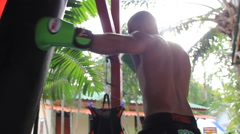 Athlete Muay Thai Boxing Training Hitting Heavy Bag Lens Flare Hand Held Stock Footage