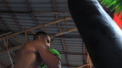 MMA Athlete Muay Thai Boxing Fight Training Hitting Heavy Bag Low Angle Stock Footage