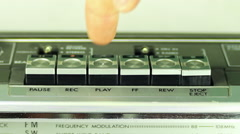 Pressing a finger play button on a tape recorder Stock Footage