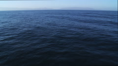 Stock Video Footage of Flight over open ocean, nearing Catalina on the horizon. Shot in 2010.