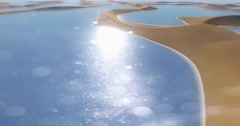 4k flying over shine lake in the desert,meandering sand dunes & blue sky. Stock Footage