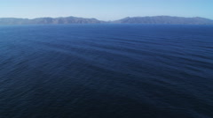 Over open water toward Isthmus Cove on Santa Catalina Island. Shot in 2010. Stock Footage