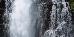 Close view of waterfall section with heavy flow on left - stock footage