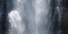 Close view of a waterfall plunging, cascading, and trickling over boulders Stock Footage