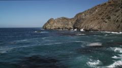 Flying toward and over a coastal cliff to reveal more of Catalina's rugged - stock footage