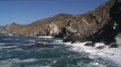 Stock Video Footage of Over rocks and surf along the Catalina coastline. Shot in 2010.