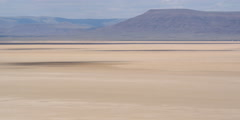 Time-lapse cloud shadows across floor of Alvord Desert  in Eastern Oregon Stock Footage