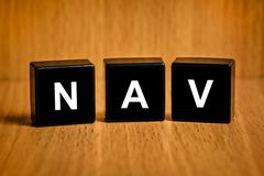 NAV or Net asset value word on black block - stock photo