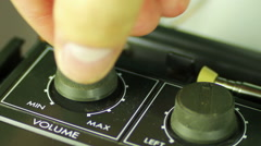 Spin the Volume Control on the Tape Recorder Stock Footage