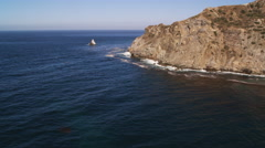 Stock Video Footage of Flying past rugged Santa Catalina coastal cliffs. Shot in 2010.