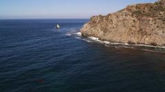 Flying past rugged Santa Catalina coastal cliffs. Shot in 2010. Stock Footage