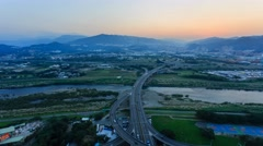 4K timelapse of aerial view of New Taipei City, from sunset to twilight Stock Footage