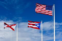 Flags atop El Morro Fortress Puerto Rico - stock photo