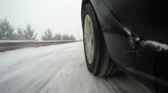 Wheel While Driving on Snow road and Passing Another Car, 4k - stock footage