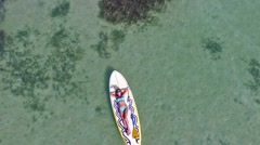 Woman taking rest paddleboarding on SUP on Samui Thailand standing Stock Footage