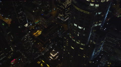 Stock Video Footage of Flying past Los Angeles skyscrapers at night. Shot in 2010.