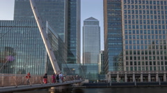 4k footbridge docklands canary wharf london finance city money business offices - stock footage