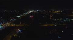 Landing on a runway at night in Los Angeles. Shot in 2010. - stock footage