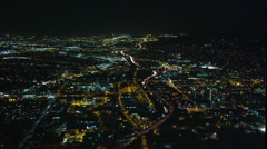 Timelapse flight over Los Angeles traffic at night, then approaching airport. Stock Footage