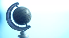 Globe at office table Stock Footage