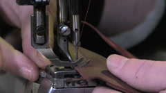 Leather goods craftsman at work in his workshop Stock Footage